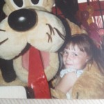 Me with Pluto circa 1984, when he still had whiskers and a tongue.